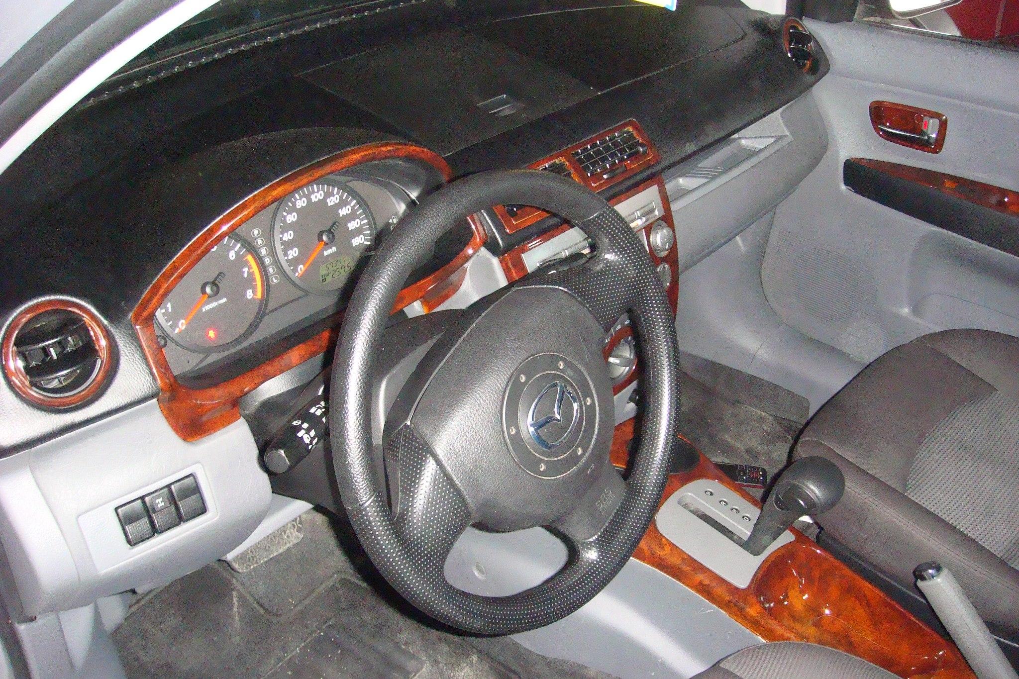 Mazda El Paso >> Reparación de tableros y Tapizados en General Auto Adornos - Negocios Dominicanos